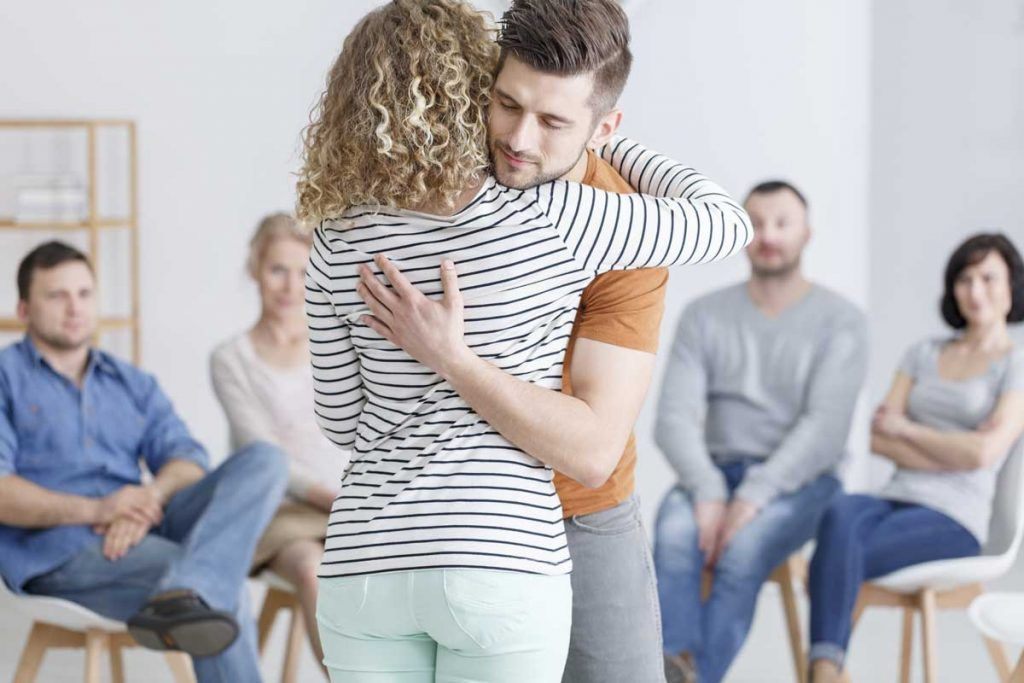 Counsellor hugs client