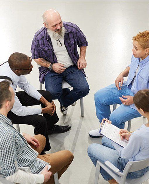 Male counsellor with clients