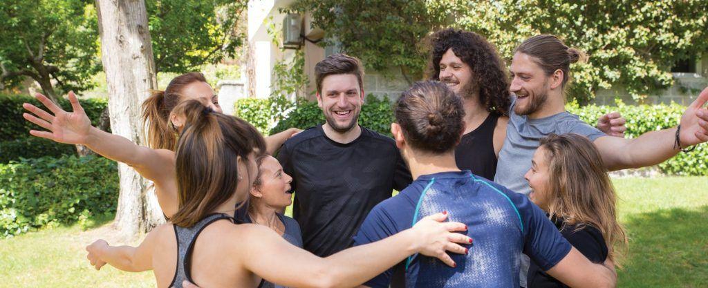 Group hug outdoors