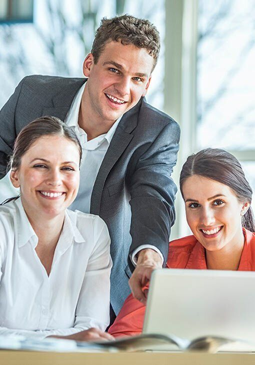 3 people at computer